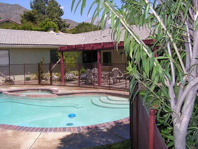 Brown Poles Match Pool Patio Cover