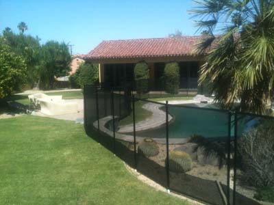 Black mesh economy pool fence in the grass Orange county